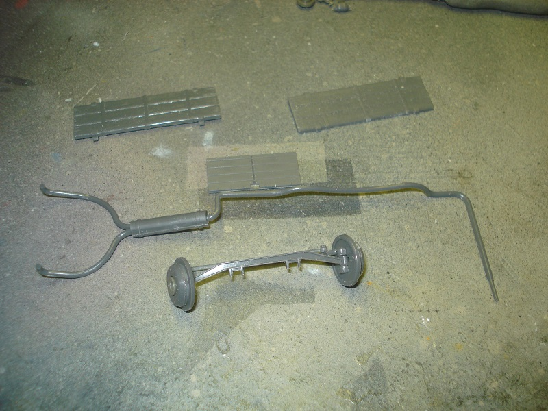 Front axle and exhaust pipes.