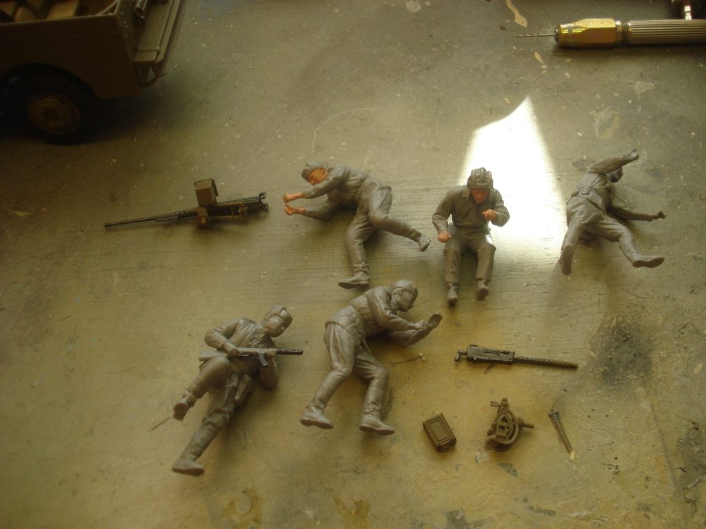 All five soldiers built